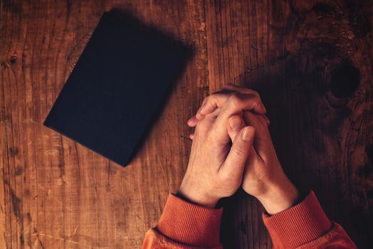 Hands of Christian woman praying