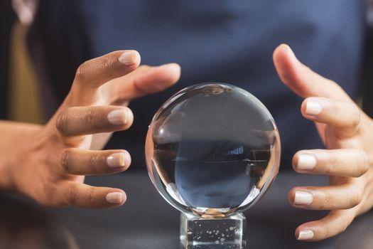 Businesswoman using crystal ball