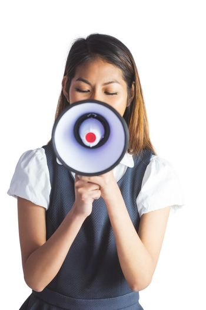 Businesswoman shooting through a megaphone