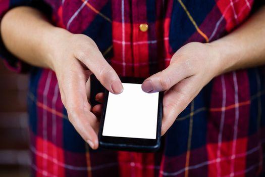 Feminine hands using smartphone
