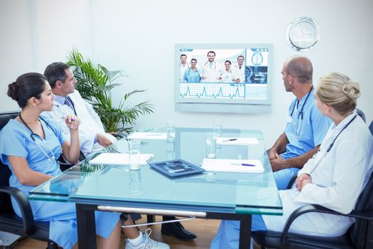 Composite image of team of doctors having a meeting