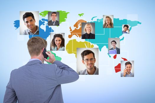 Composite image of back turned businessman on the phone