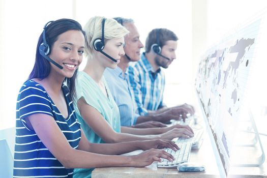 Composite image of casual call centre workers in the office