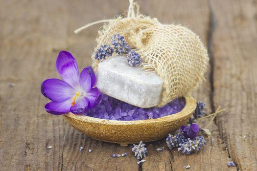 bar of natural soap, bath salt, dried lavender and crocus