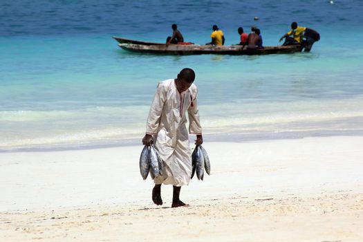 Zanzibar, Tanzania - January 7, 2016: Traditional fish market on the beach in Nungwi. Zanzibar
