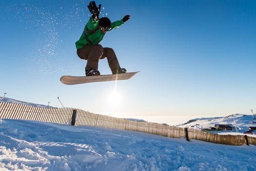 Snowboarder at jump