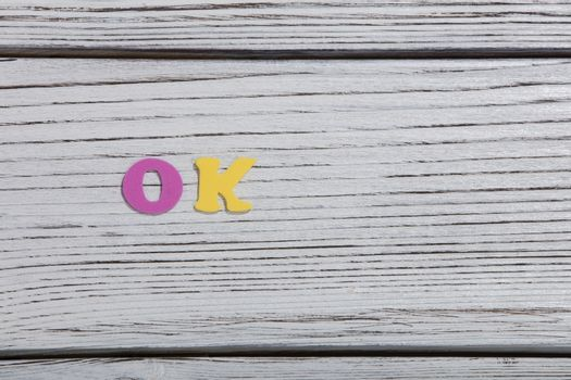 colorful words on white wooden background