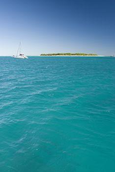 Tranquil island on ocean horizon