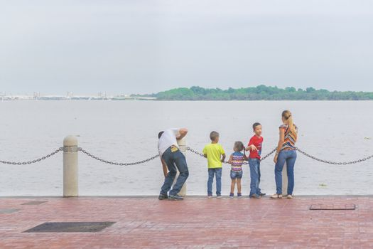 Young Familiy Watching the River at the Boardwalk