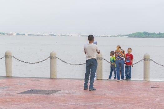 Father Taking a Photo of his Familiy at the Boardwalk