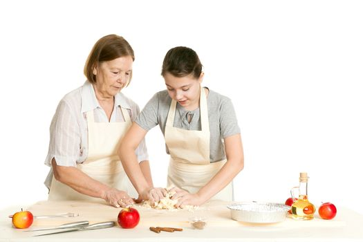 the grandmother and the granddaughter knead dough