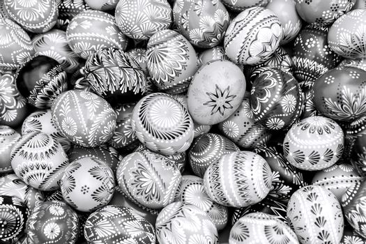 Black and white pile of decorated easter eggs, full frame background