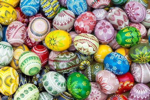Colorful pile of decorated easter eggs, full frame background