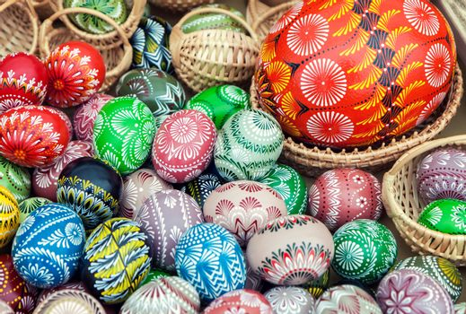 Pile of colorful, decorated easter eggs