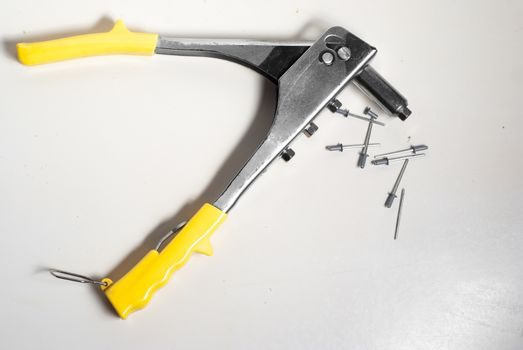 rivets and rivet pliers isolated