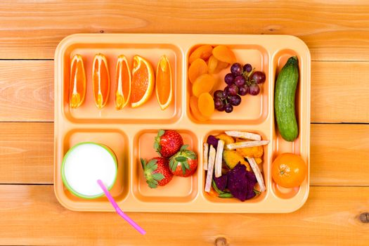 Fruit sampler in lunch tray with milk