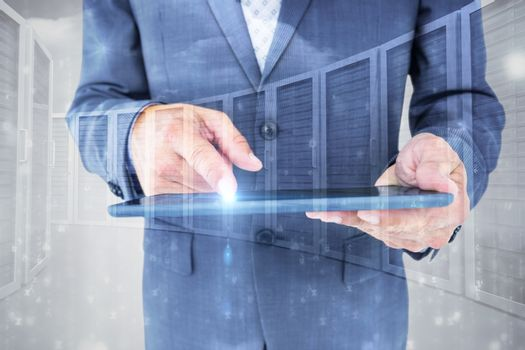 Composite image of  close up view of businessman using tablet computer
