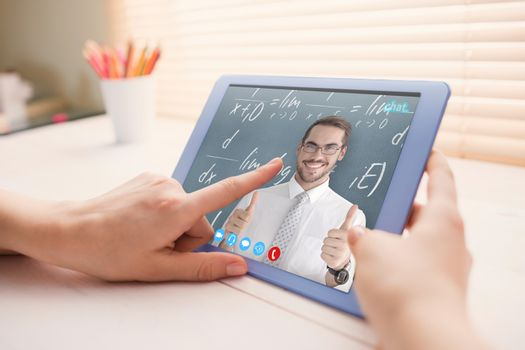 Positive businessman posing with thumbs up against cropped image of person using on digital tablet