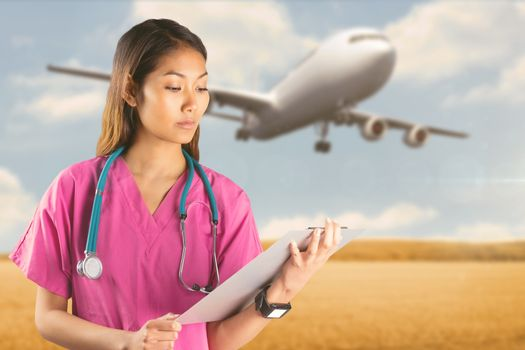 Asian nurse with stethoscope looking at the camera against bright brown landscape