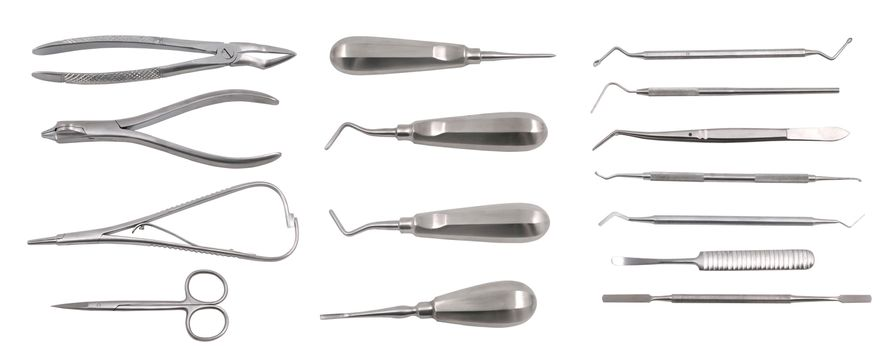 Top view of a complete set of dentist equipment and tools isolated on white background