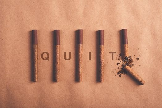 Quit smoking concept, flat lay arranged cigarettes
