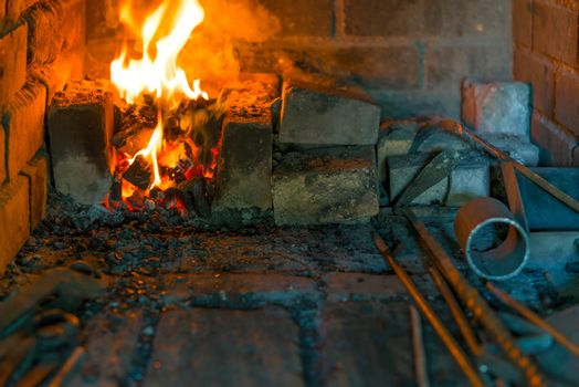 burning fire in the furnace in the smithy