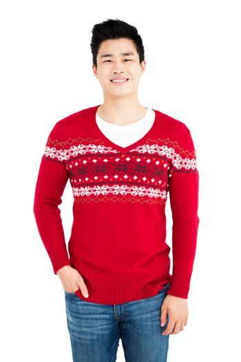 Happy man in red pullover smiling at camera