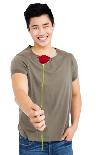 Portrait of happy young man holding bunch of red roses on white background