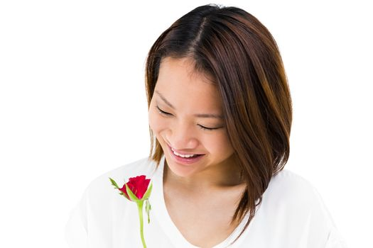 Happy woman holding red rose on white background