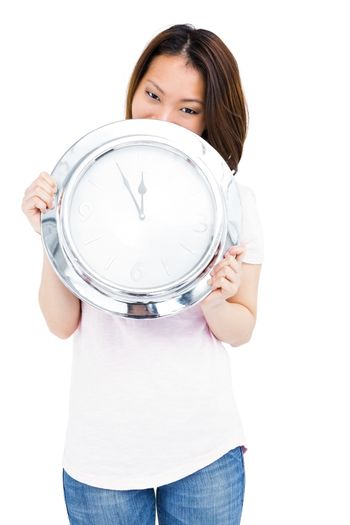 Young woman holding stainless steel clock