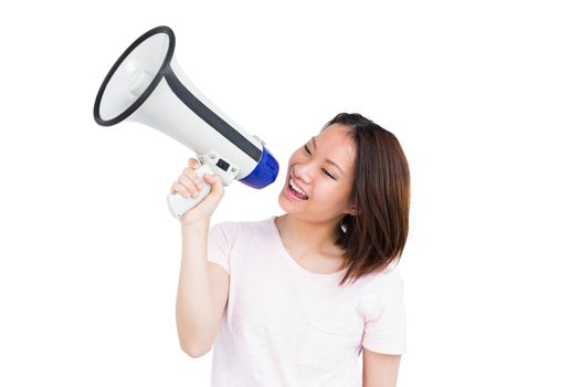 Young woman talking on horn loudspeaker