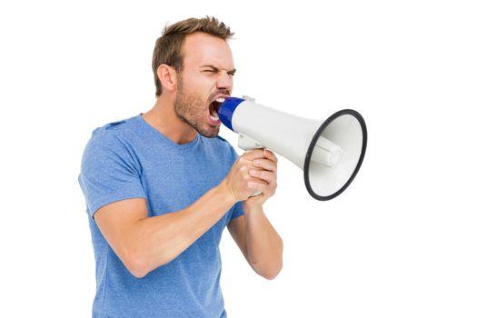 Young man shouting on horn loudspeaker