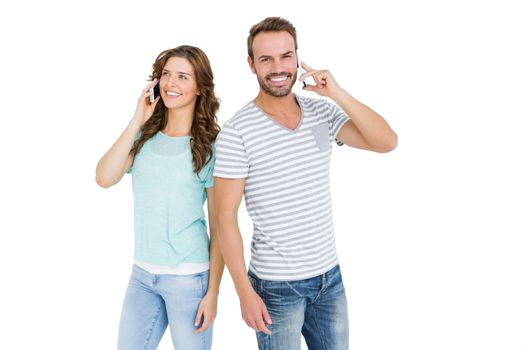 Happy young couple talking on mobile phone