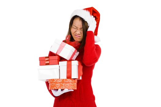 Woman in christmas attire holding gifts