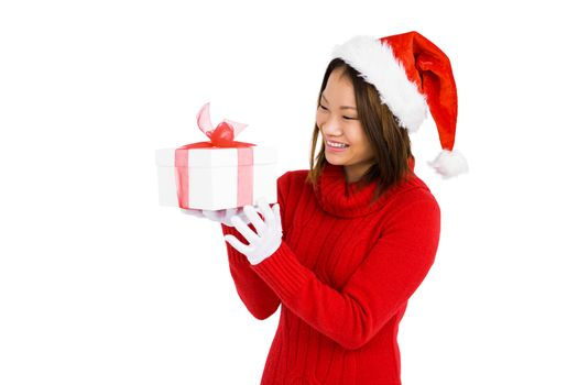 Woman in christmas attire holding gift