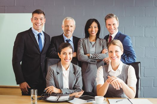 Portrait of businesspeople smiling in conference room