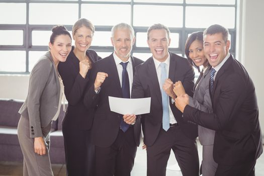 Team of businesspeople with certificate