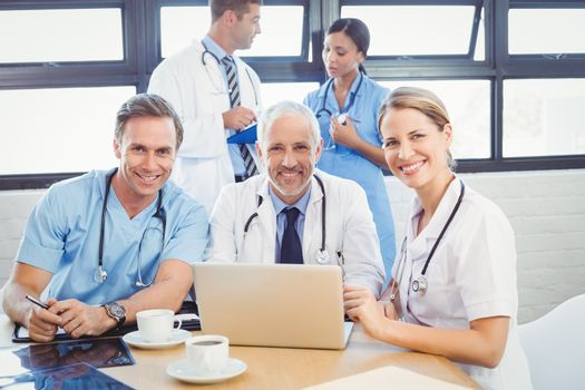 Portrait of happy medical team smiling in conference room in hospital