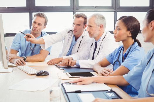 Medical team interacting at a meeting in conference room in hospital