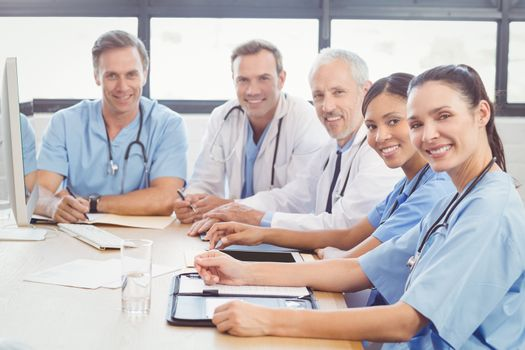 Portrait of happy medical team in conference room in hospital