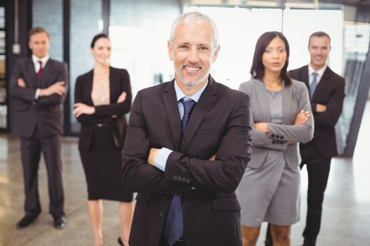 Businesspeople standing with arms crossed