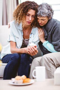Mother comforting worried daughter