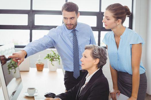 Businessman explaining colleagues
