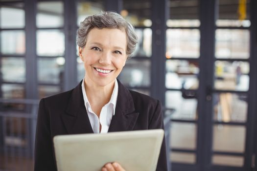 Confident businesswoman using digital tablet