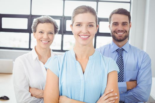 Smiling business people standing in office
