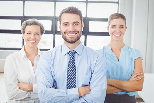 Cheerful business people with arms crossed