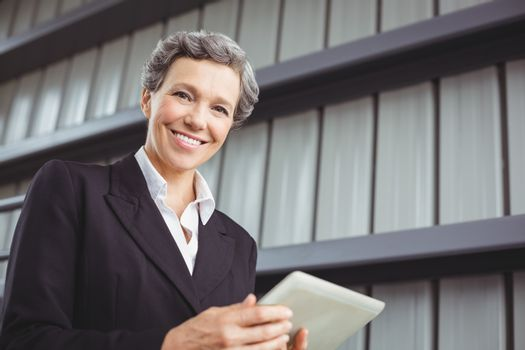 Portrait of businesswoman using digital tablet