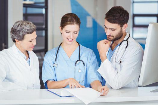 Doctor team working at computer desk