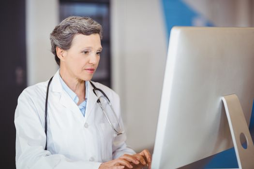 Doctor working at computer desk