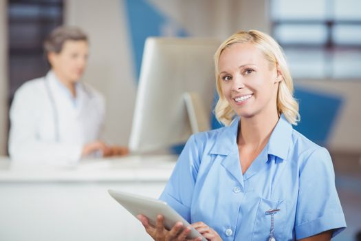 Portrait of pretty female doctor with digital tablet